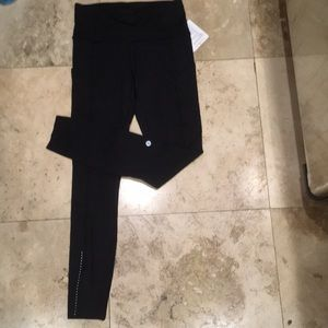 NWT black fast and free 7/8 tight 4